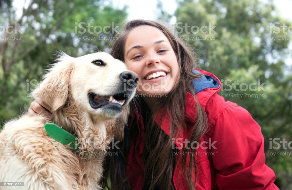 Girl petting the dog stock photo