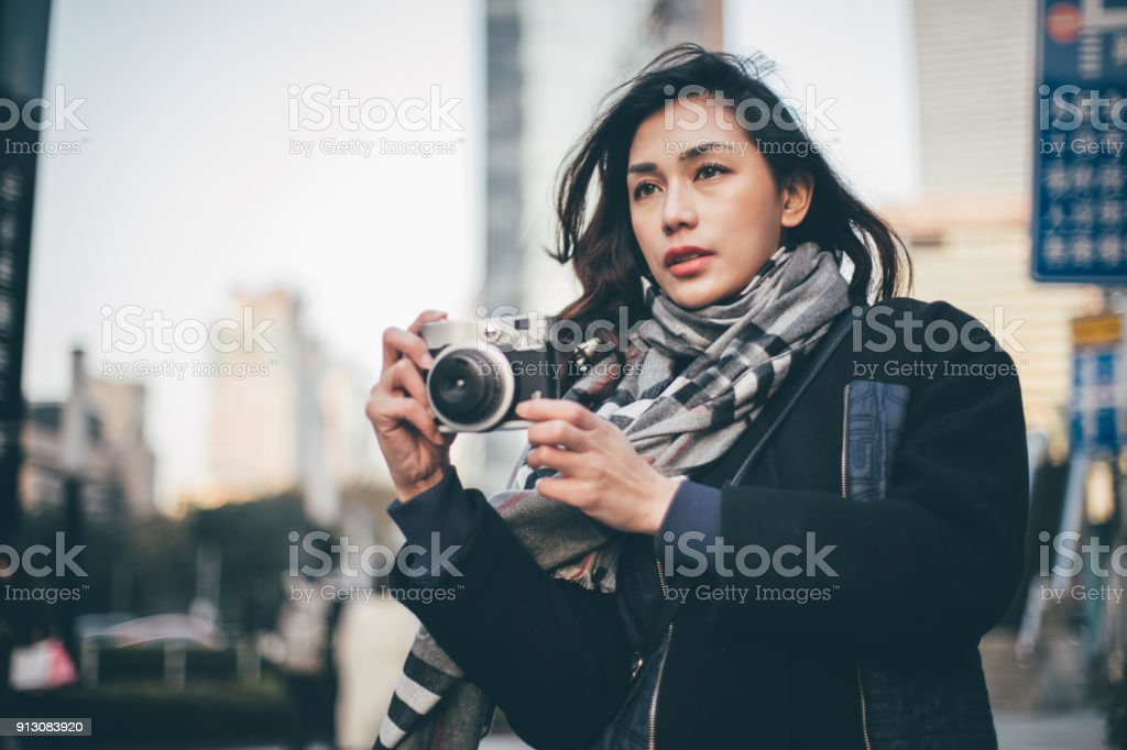 Girl photographer downtown stock photo