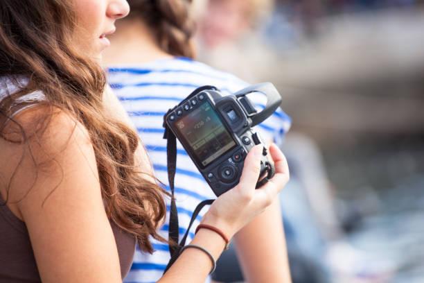 Girl photographer holding an entry level photo camera picture id1178752121?b=1&k=6&m=1178752121&s=612x612&w=0&h=yv3kqpyhyzrxujm kvtx rwe7p 8czhqotnemkeyby8=