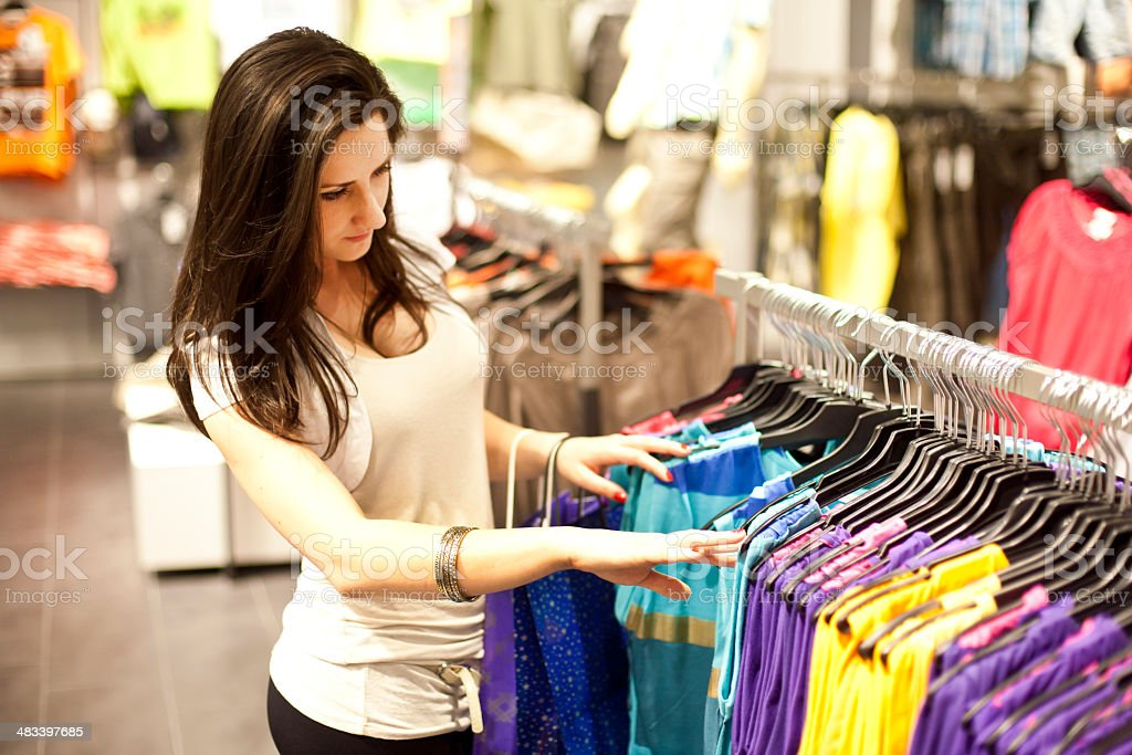 Girl picking clothes stock photo