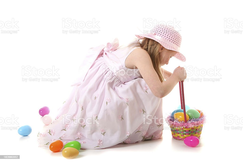 girl picking up easter eggs royalty-free stock photo