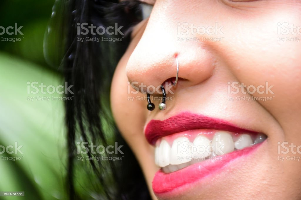 Girl piercing stock photo