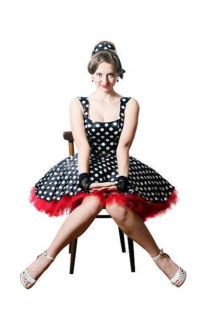 girl pin-up style, sitting on a chair - frau tiefer ausschnitt stock-fotos und bilder