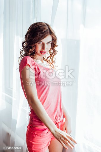 girl pinup-style in a pink dress 1 2