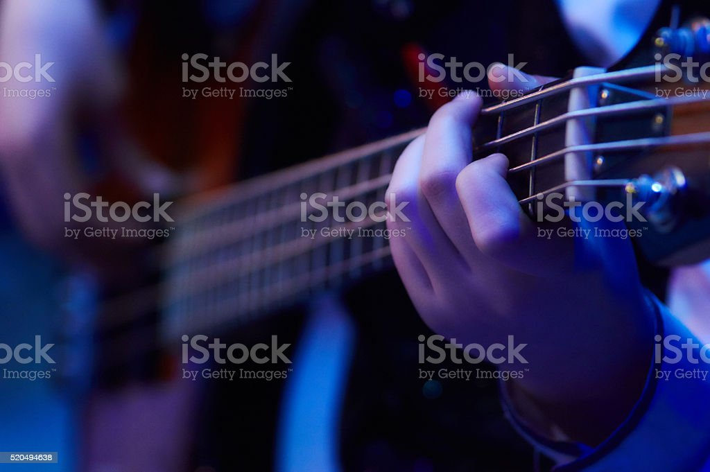 girl plaing bass guitar stock photo