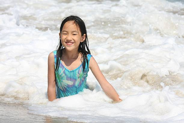 girl play at the beach stock photo