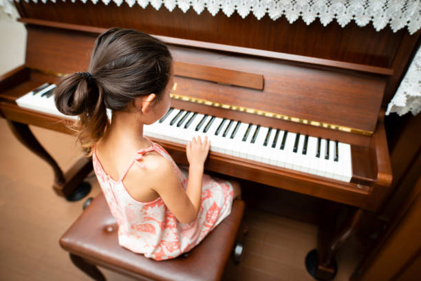Girl play the piano Girl play the piano keyboard player stock pictures, royalty-free photos & images