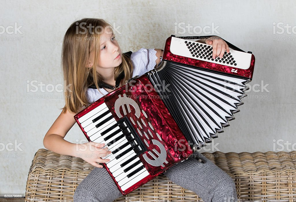 Girl playing an Accordion zbiór zdjęć royalty-free