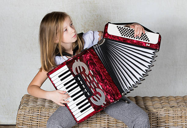 Girl playing an Accordion stock photo