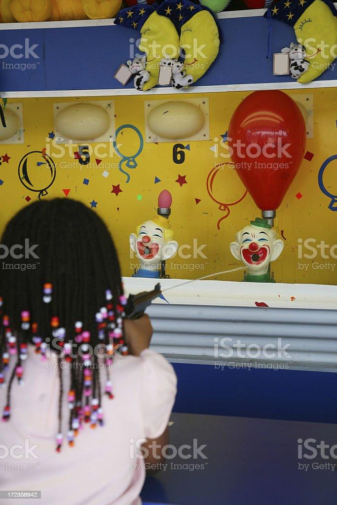 Girl Playing At Amusement Park royalty-free stock photo