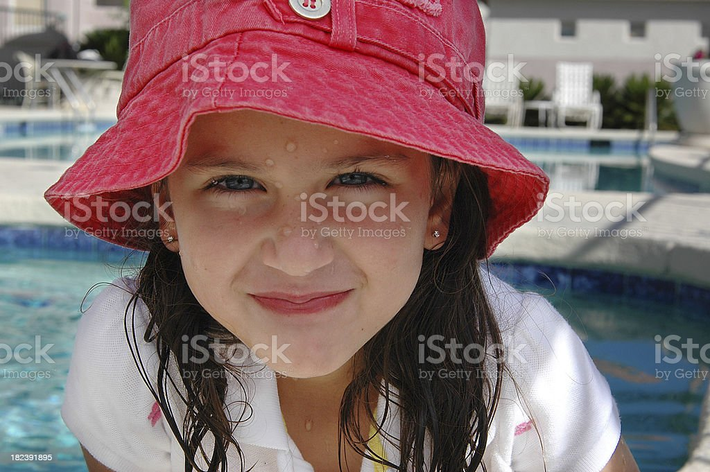 Girl Playing At Resort Swimming Pool stock photo