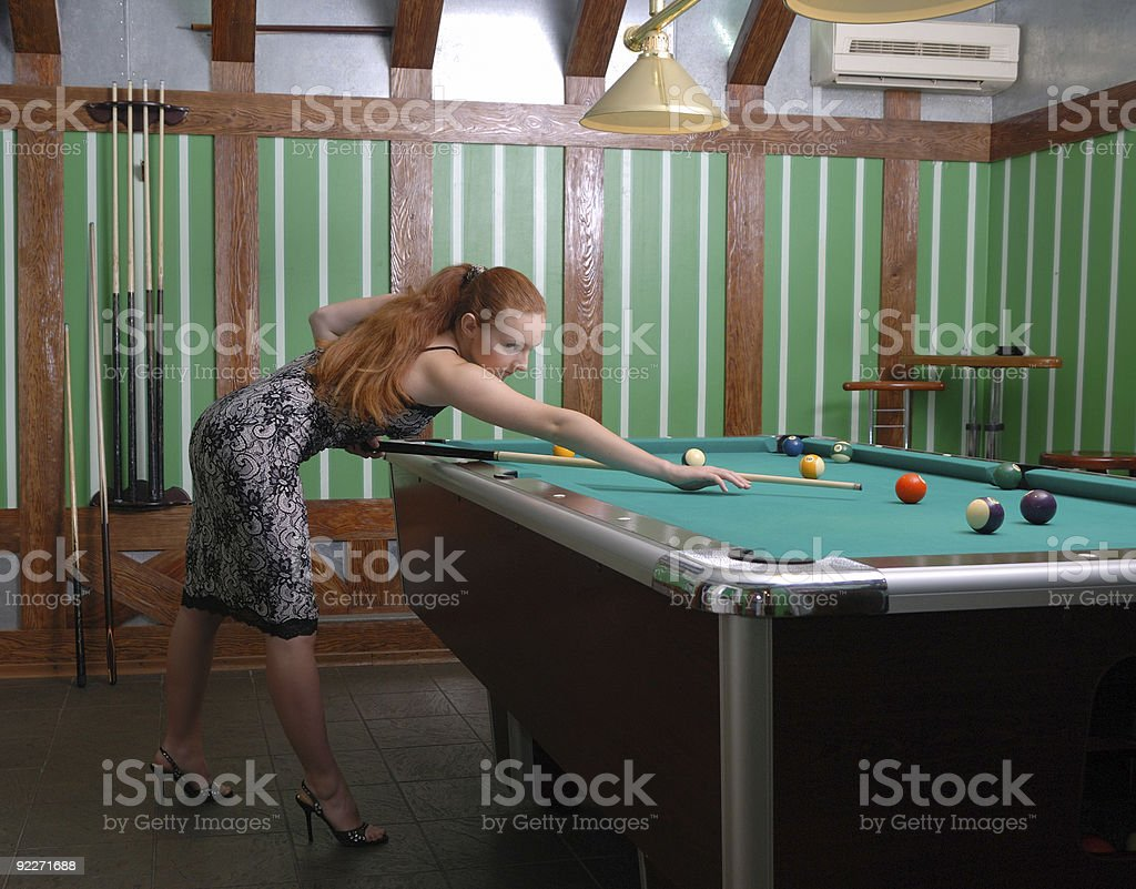 Girl playing billiards royalty-free stock photo