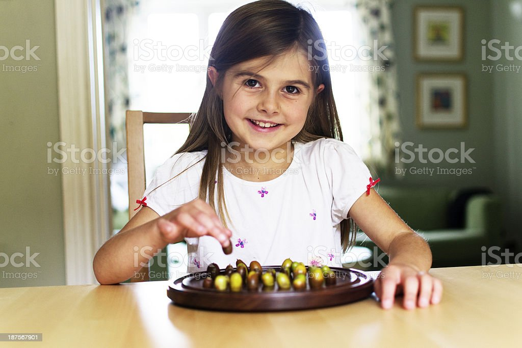 Girl playing board game royalty-free stock photo