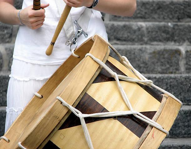Girl playing Brazilian alfaia drum stock photo