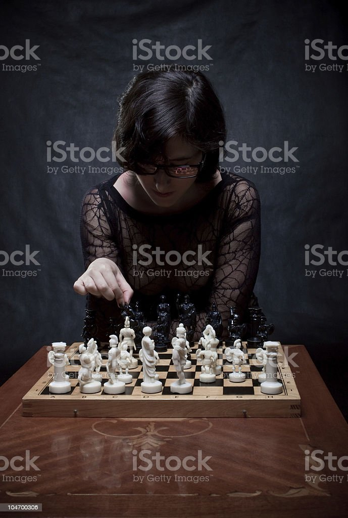 Girl playing chess royalty-free stock photo