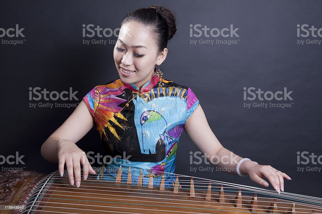 girl playing Chinese zither stock photo
