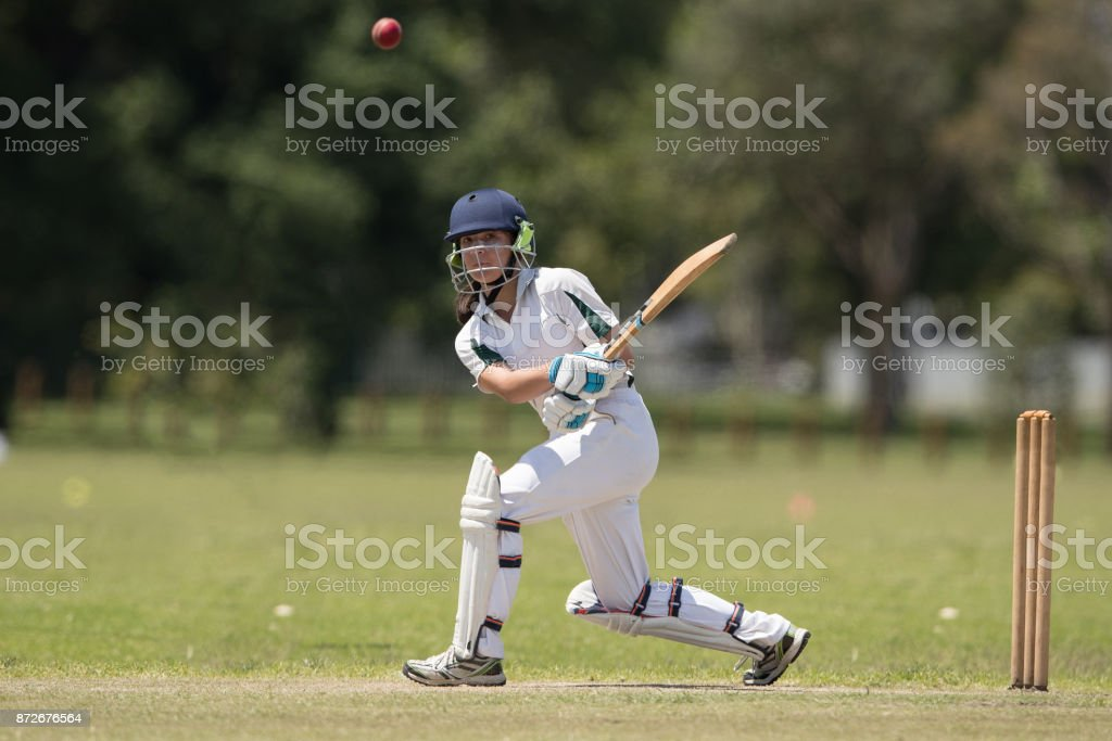 Girl playing cricket stock photo