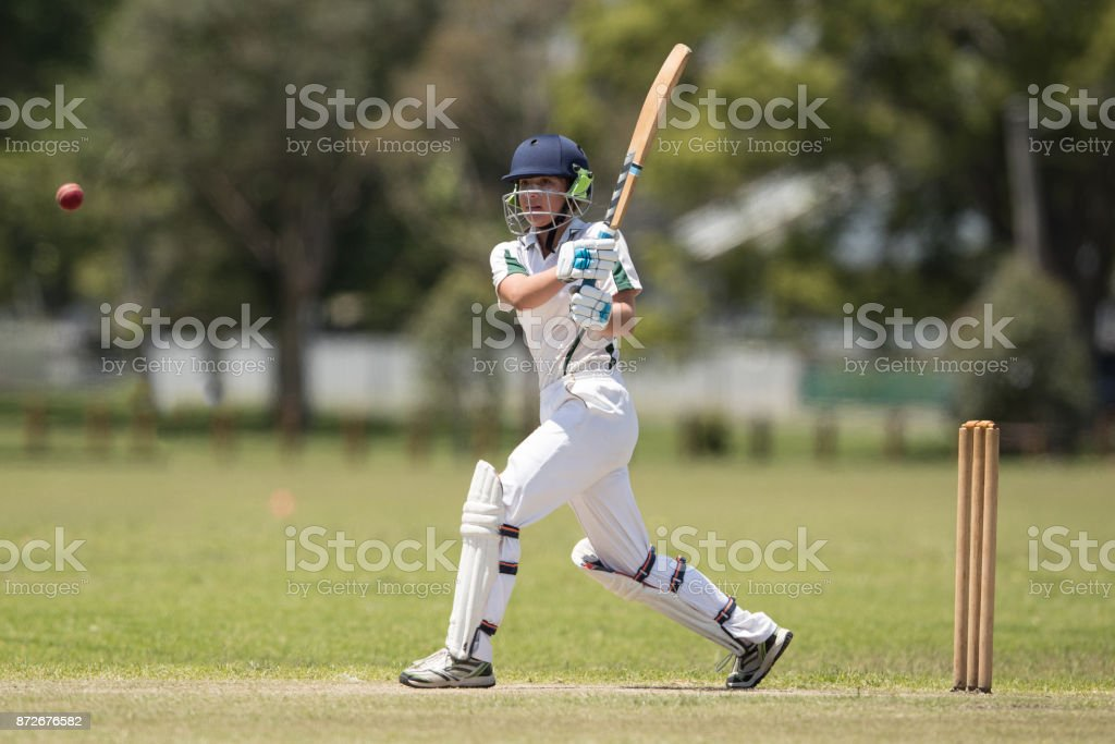Girl playing cricket