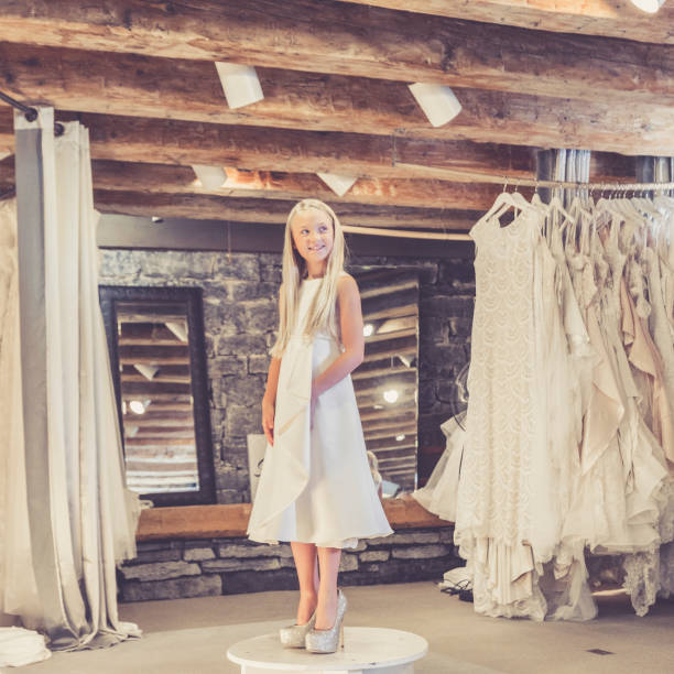 girl playing dress up at bridal shop - katiedobies stock pictures, royalty-free photos & images