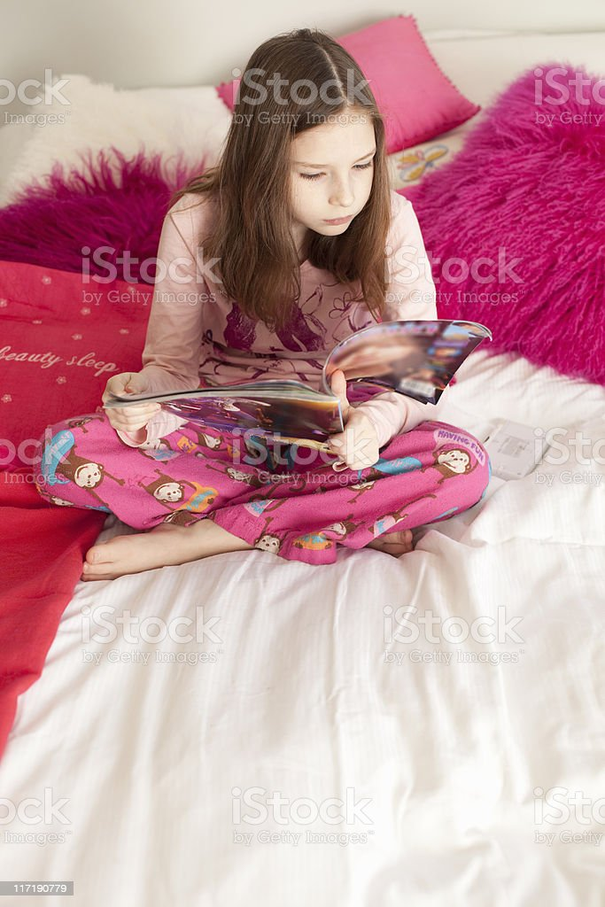 girl playing game on bed stock photo