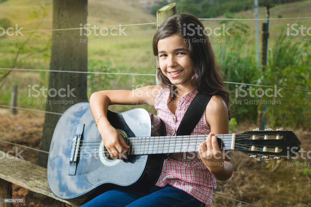 Girl Playing Guitar