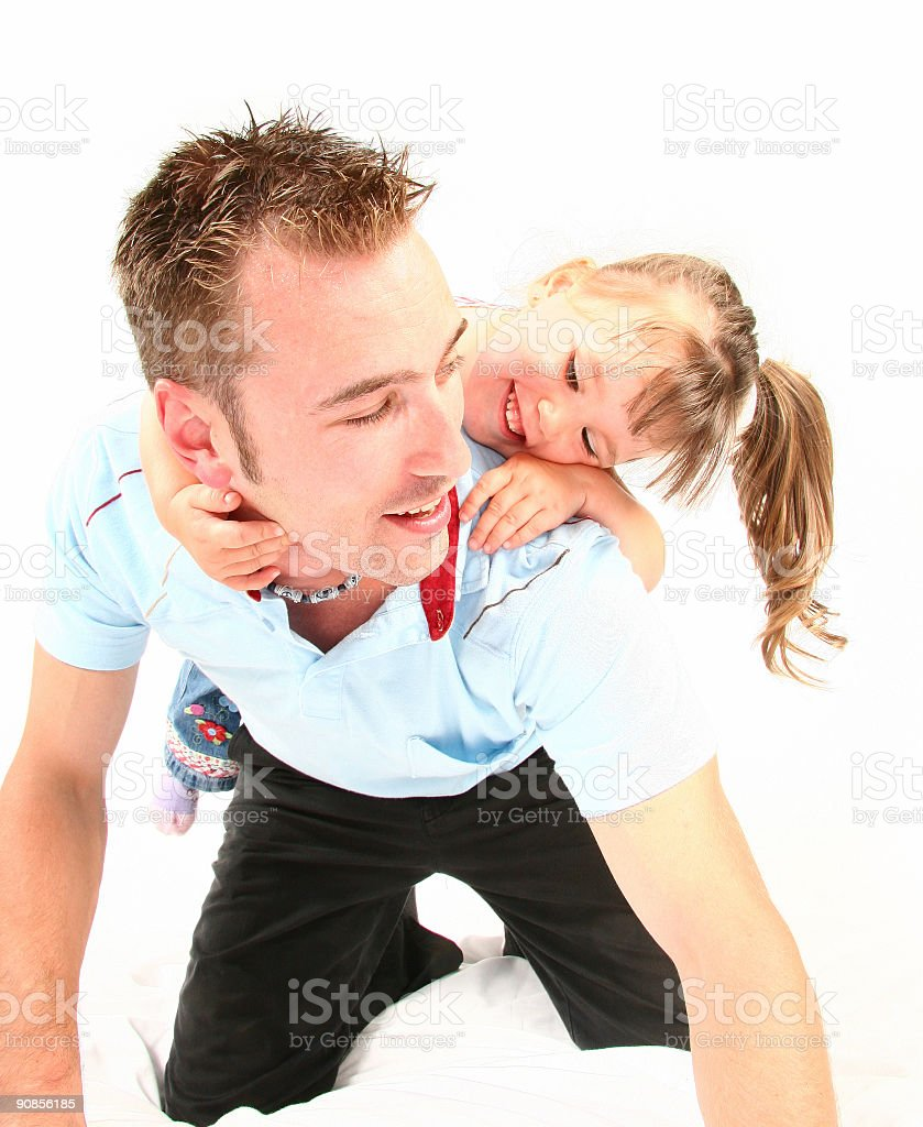 Girl playing horse on father stock photo