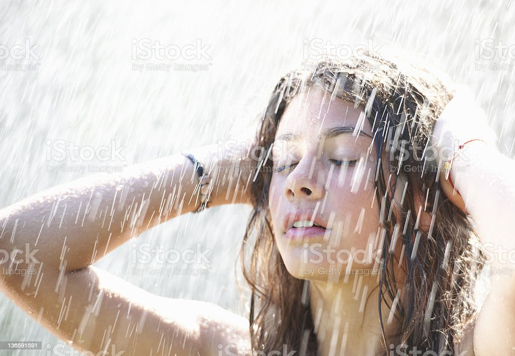 Girl playing in rain stock photo