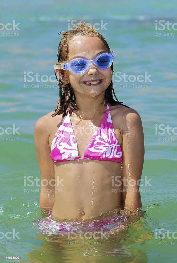 Girl playing in sea royalty-free stock photo