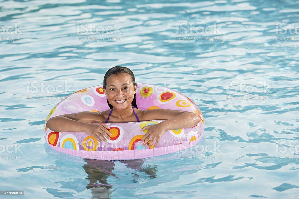 Girl playing in swimming pool. royalty-free stock photo