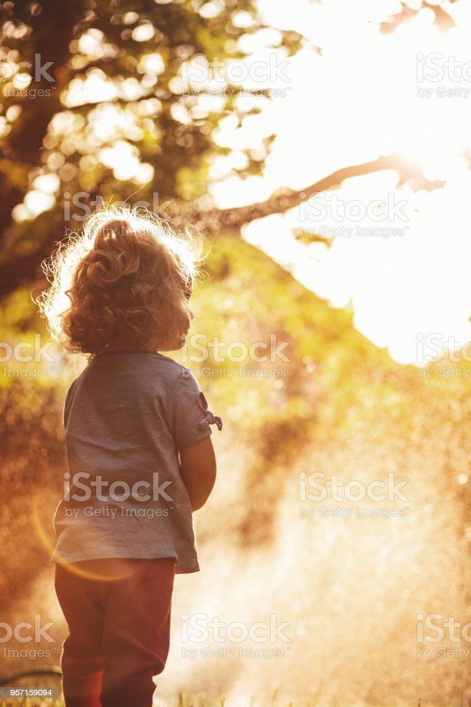 Girl playing in the frontyard stock photo