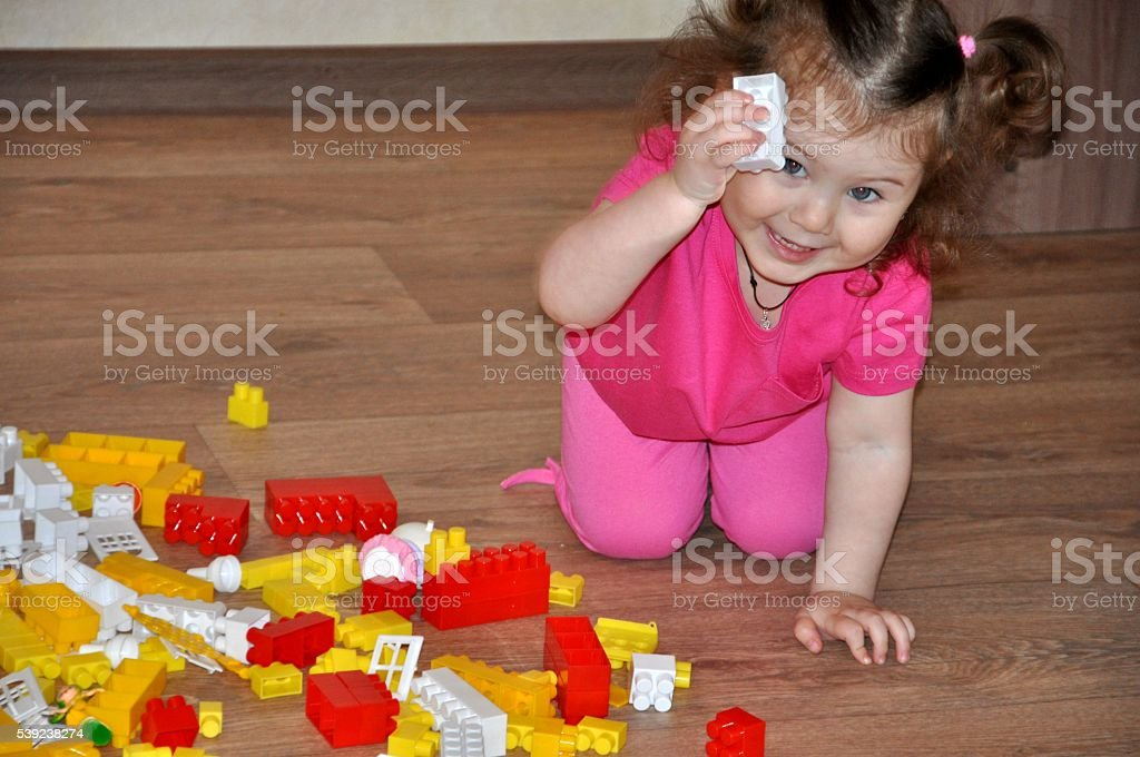 Girl playing in the house designer or kindergarten royalty-free stock photo