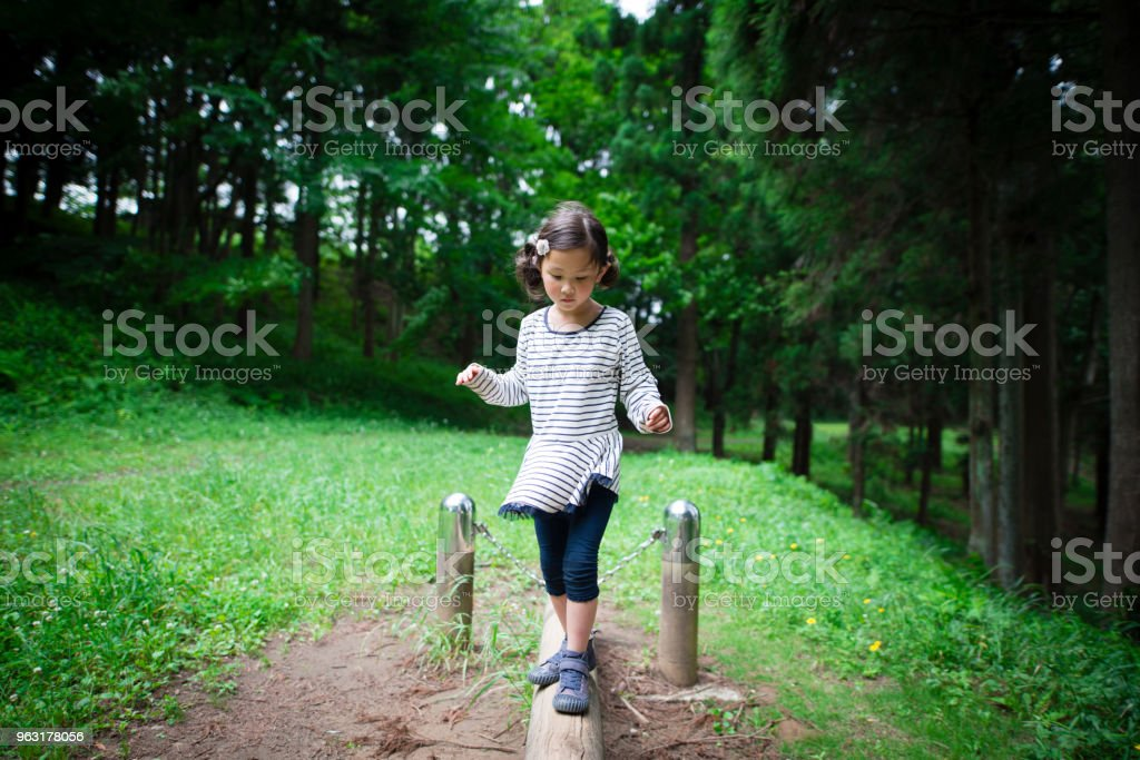 Girl playing in the park stock photo