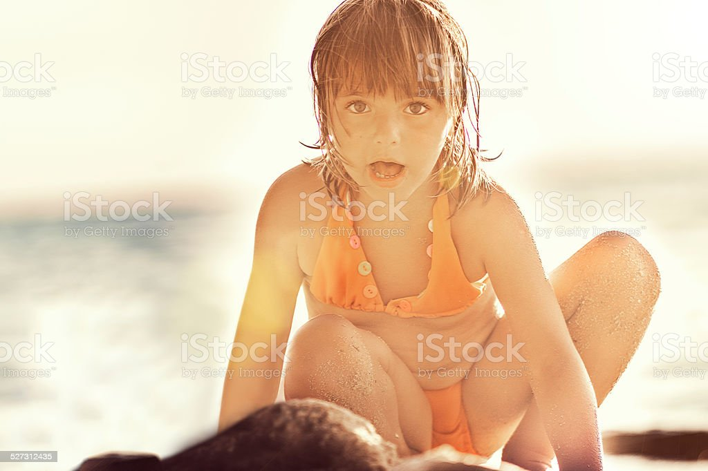 Girl playing in the sand stock photo