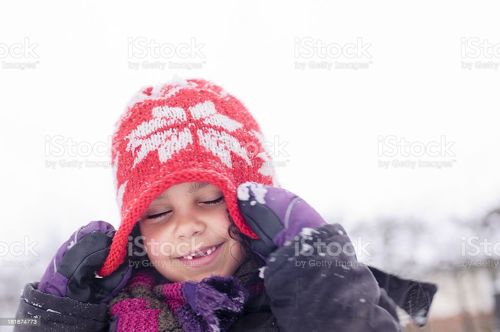 Girl (6-7) Playing in The Snow royalty-free stock photo