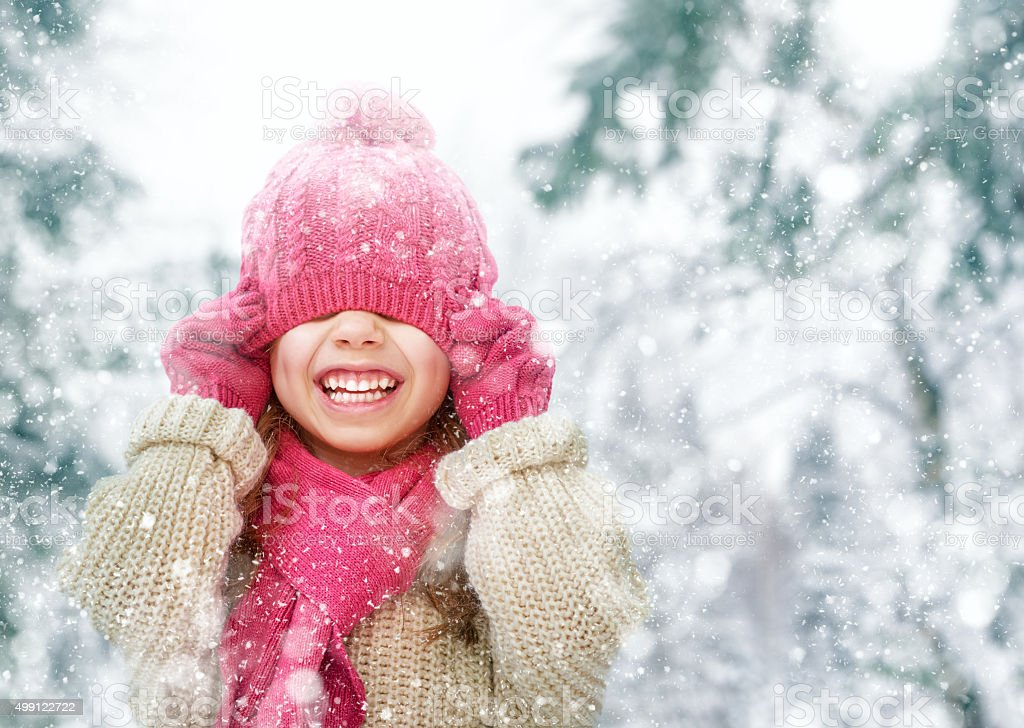 girl playing on a winter walk stock photo