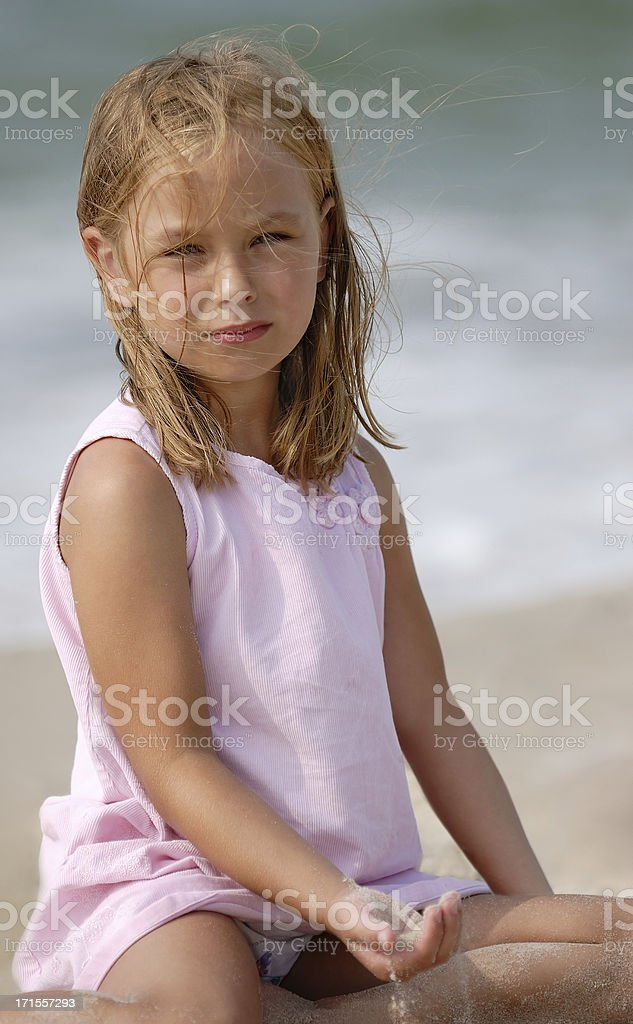 Girl playing on the beach royalty-free stock photo
