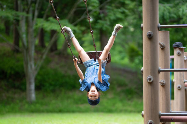 Girl playing on the swing stock photo