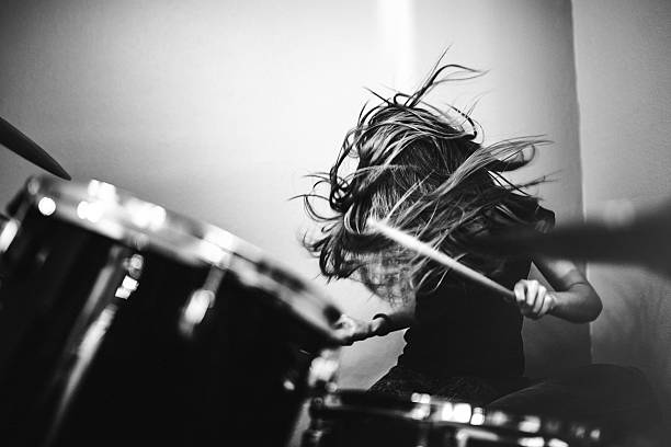 girl playing rock and roll drums - rock music stock pictures, royalty-free photos & images
