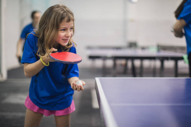 girl playing table tennis - racket sport stock pictures, royalty-free photos & images