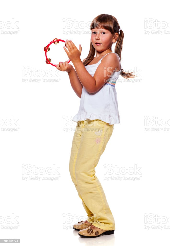 Girl playing tambourine foto stock royalty-free
