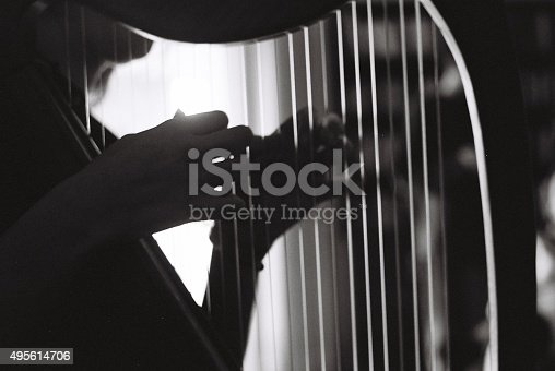 Girl playing an irish harp. Photographed in Israel using analog photography.