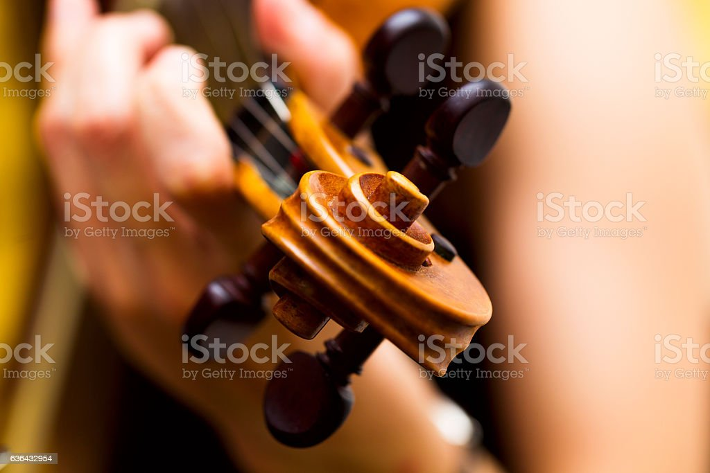 Girl playing the violin classical music concert stock photo