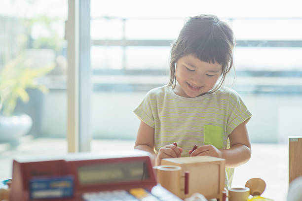 girl playing together at home - 子供時代 ストックフォトと画像