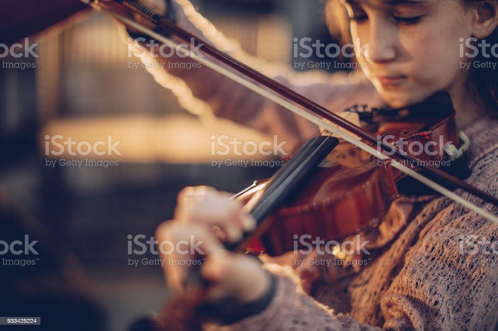 Girl playing violin stock photo