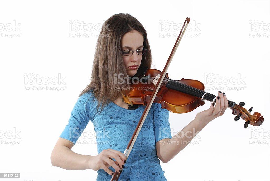 Girl playing violin royalty-free stock photo