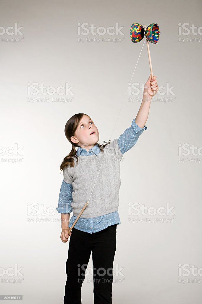 A girl playing with a diabolo 免版稅 stock photo