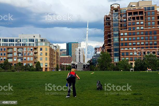Girl playing with a dog in Denver