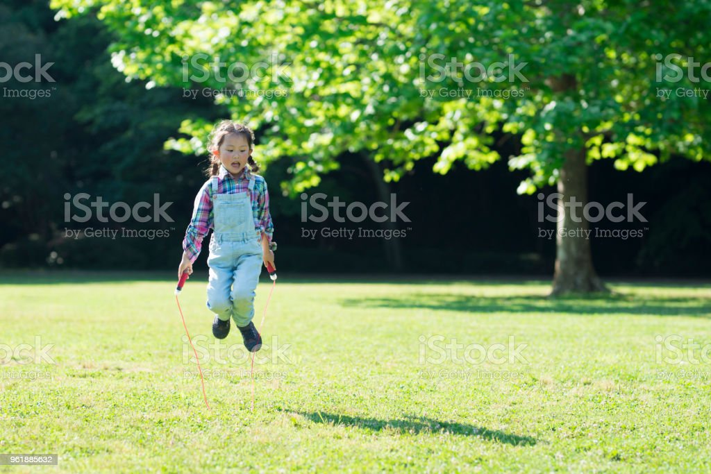 Girl playing with a jump rope stock photo