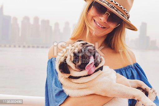 Pet, Love, Care, Dubai - Girl Enjoying a Day Out with Her Pug Near Dubai Marina