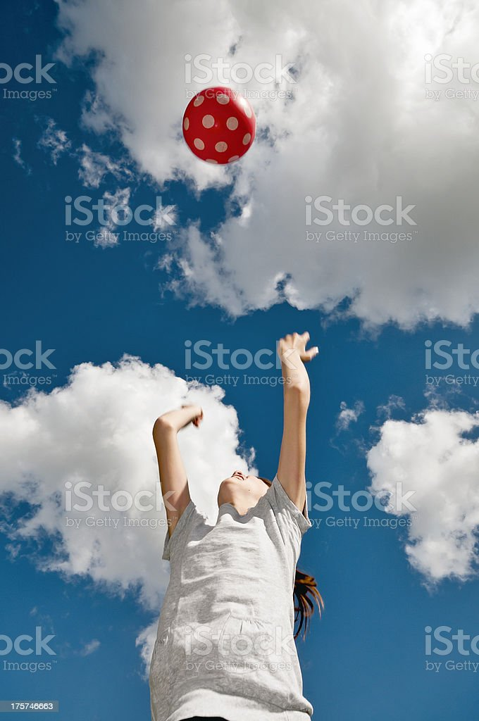 Girl playing with a red ball royalty-free stock photo